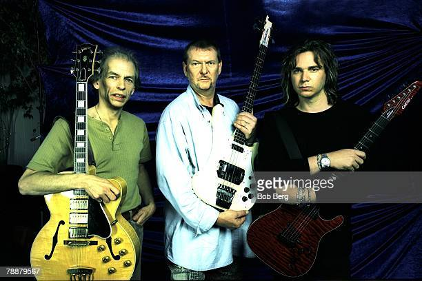 English progressive rock band Yes lead guitarist Steve Howe bassist Chris Squire and guitarist/keyboardist Billy Sherwood pose for a January 1999...