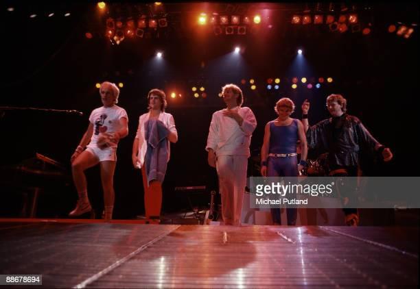 English progressive rock group Yes on stage Florida USA 1984 Left to right drummer Alan White guitarist Trevor Rabin singer Jon Anderson keyboard...