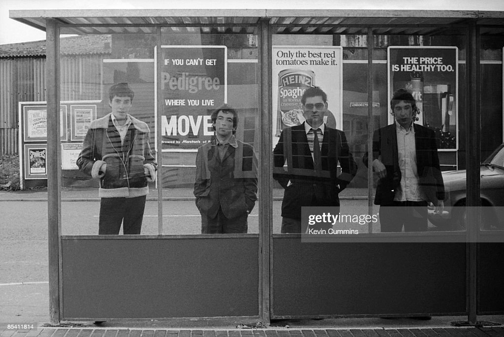 English punk band The Buzzcocks at a bus stop 28th September 1977 Left to right drummer John Maher singer Pete Shelley bassist Garth Smith and...
