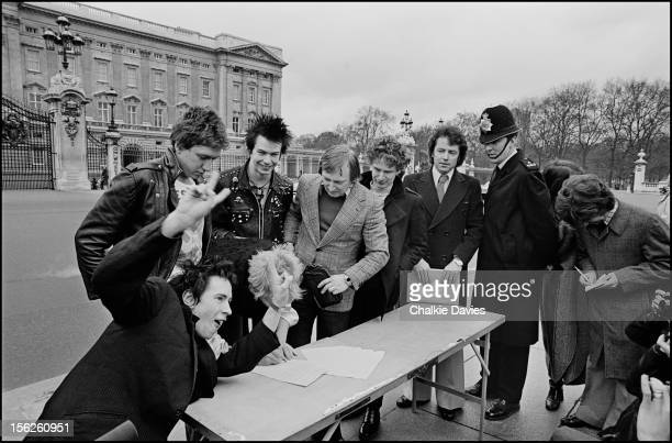 English punk group the Sex Pistols with their manager Malcolm McLaren sign their recording Contract with AM outside Buckingham Palace London after...