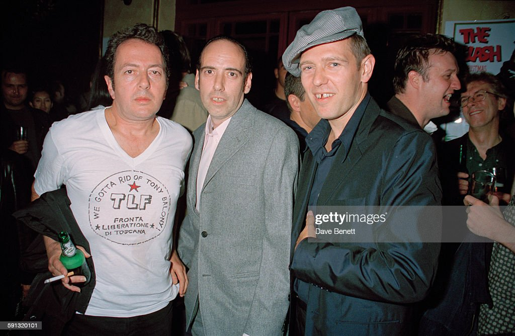English punk rock band The Clash at a party for the documentary film 'The Clash: Westway to the World' at the Cobden Club, London, 21st September 1999. From left to right, <a gi-track='captionPersonalityLinkClicked' href=/galleries/search?phrase=Joe+Strummer&family=editorial&specificpeople=226957 ng-click='$event.stopPropagation()'>Joe Strummer</a> (1952 - 2002), <a gi-track='captionPersonalityLinkClicked' href=/galleries/search?phrase=Mick+Jones+-+Musician+-+The+Clash&family=editorial&specificpeople=212985 ng-click='$event.stopPropagation()'>Mick Jones</a> and <a gi-track='captionPersonalityLinkClicked' href=/galleries/search?phrase=Paul+Simonon&family=editorial&specificpeople=216507 ng-click='$event.stopPropagation()'>Paul Simonon</a>.