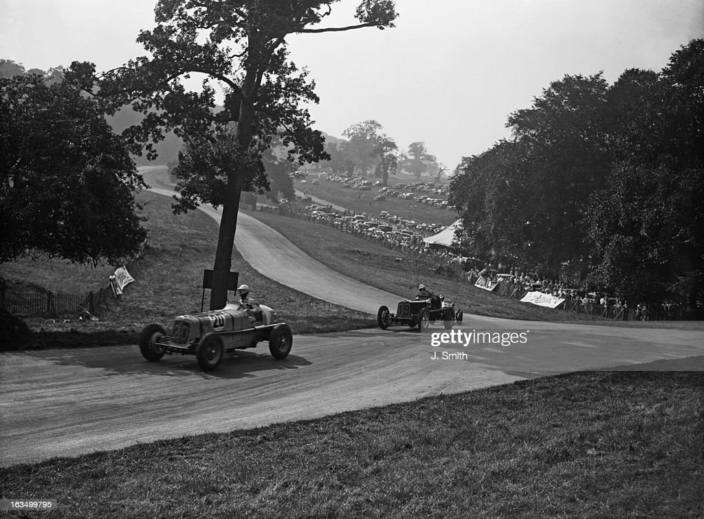 English racing driver Austin Dobson in an Alfa Romeo leads the ERA of Peter Walker during practice for the Junior Car Club 200 Miles Race at...