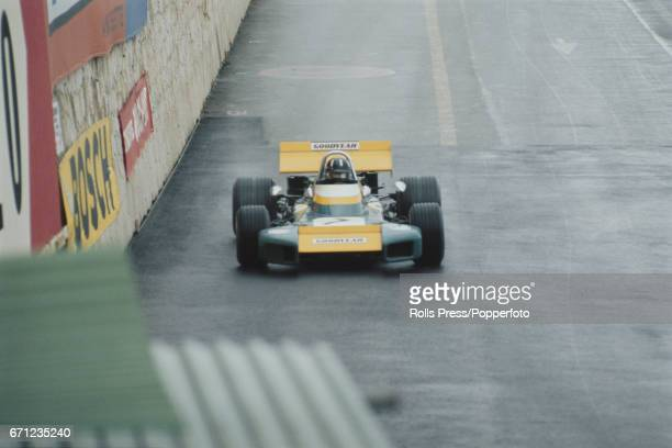 English racing driver Graham Hill drives the Brabham BT37 Ford Cosworth DFV 30 V8 for Motor Racing Developments Ltd in the 1971 Monaco Grand Prix in...