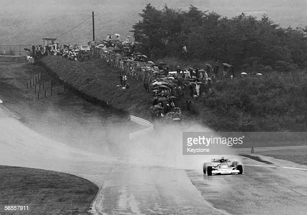 English racing driver James Hunt leads the field in heavy rain at the Japanese Grand Prix at the Fuji Speedway near Yokohama 24th October 1976 Hunt...