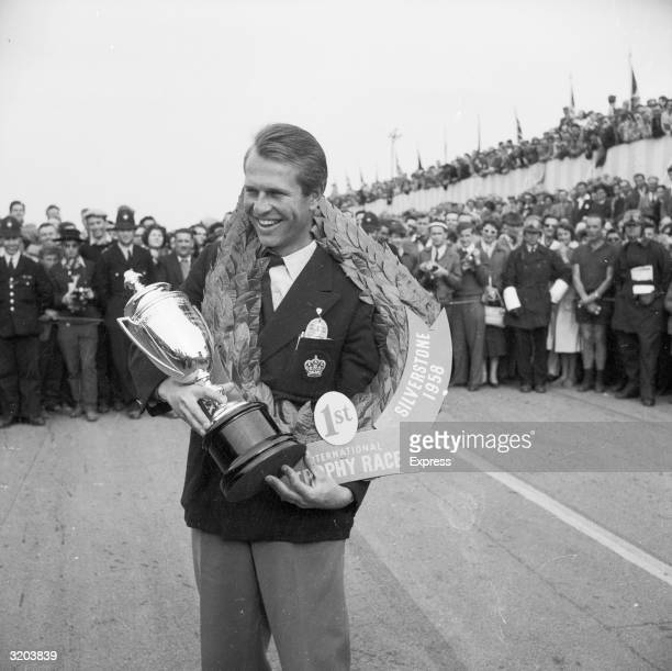 English racing driver Peter Collins winner of the Daily Express International Trophy Race at Silverstone