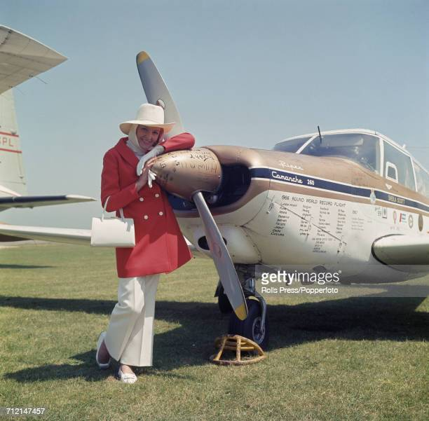 English record breaking aviator Sheila Scott stands beside her Piper Comanche 260 light aircraft at the opening of a new terminal building at Lympne...