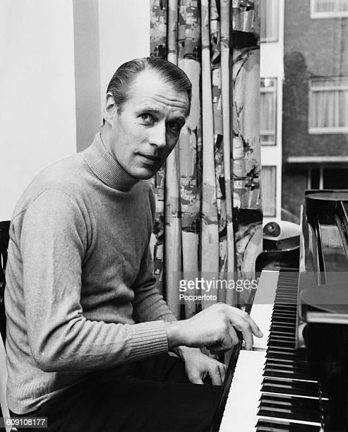 English record producer George Martin at a piano circa 1968