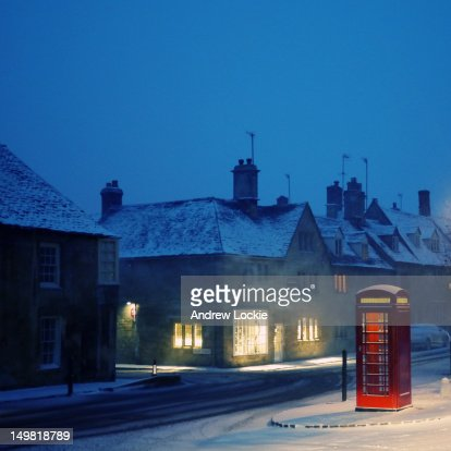 English red telephone booth, in snow : Stock Photo