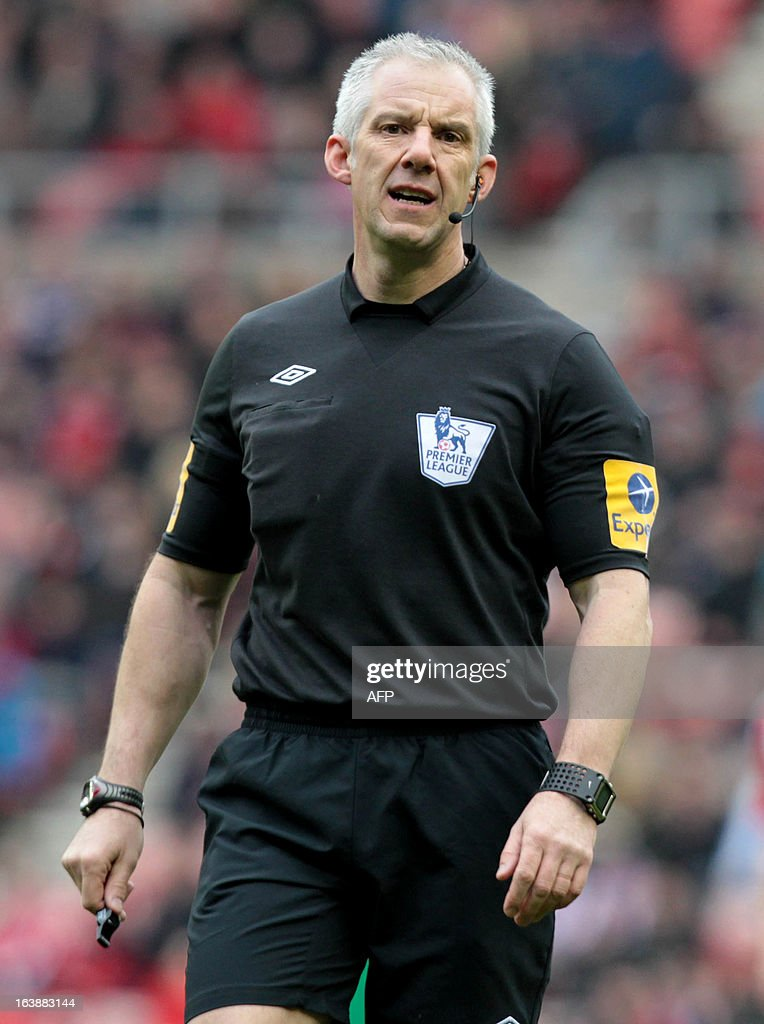 "English referee Chris Foy is pictured during the English Premier League football match between Sunderland and Norwich City at The Stadium of Light in Sunderland, north-east England, on March 17, 2013. USE. No use with unauthorized audio, video, data, fixture lists, club/league logos or ""live"" services. Online in-match use limited to 45 images, no video emulation. No use in betting, games or single club/league/player publications."