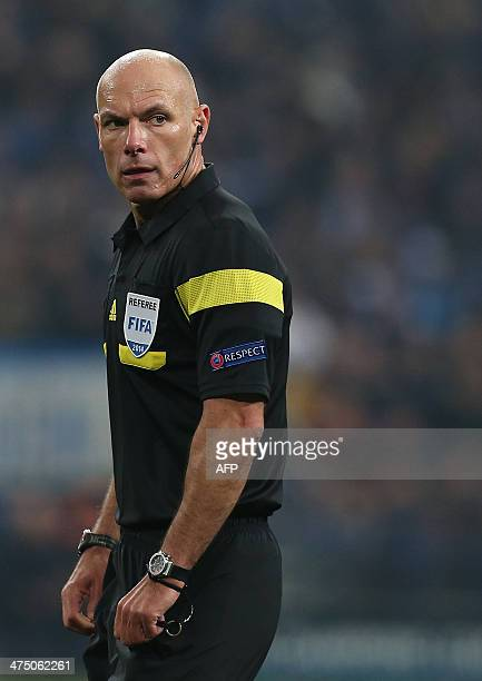 English referee Howard Webb looks on during the firstleg round of 16 UEFA Champions League football match Schalke 04 vs real Madrid in Gelsenkirchen...