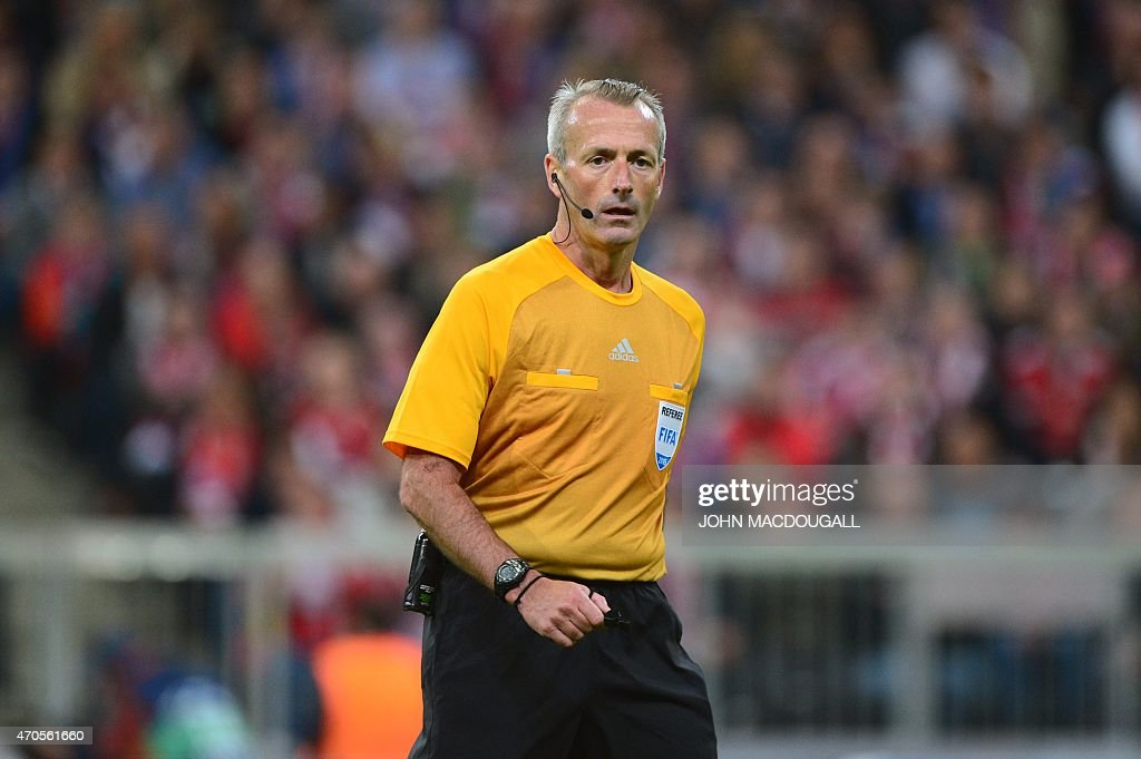 English Referee <a gi-track='captionPersonalityLinkClicked' href=/galleries/search?phrase=Martin+Atkinson&family=editorial&specificpeople=703318 ng-click='$event.stopPropagation()'>Martin Atkinson</a> reacts during the UEFA Champions League second-leg quarter-final football match Bayern Munich v FC Porto in Munich, southern Germany on April 21, 2015.