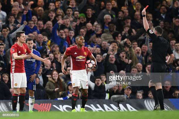 English referee Michael Oliver shows a red card for a second bookable offence to Manchester United's Spanish midfielder Ander Herrera during the...