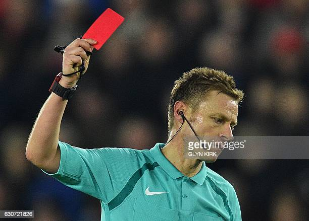 English referee Mike Jones shows a red card to to Southampton's Dutch defender Virgil van Dijk during the English Premier League football match...