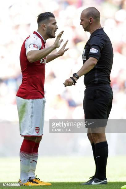 English referee Robert Madley speaks with Arsenal's Germanborn Bosnian defender Sead Kolasinac during the English FA Community Shield football match...