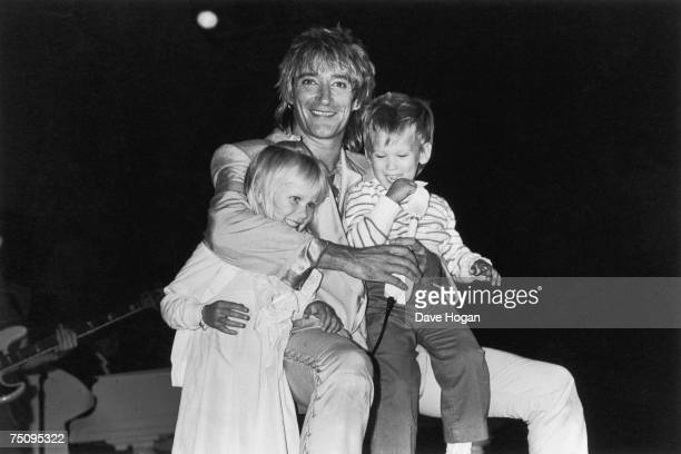English rock and pop singersongwriter Rod Stewart with his children Kimberly and Sean 1983