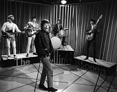 English rock and roll group Rolling Stones perform on a television show in 1965 From left to right Brian Jones Keith Richards Mick Jagger Charlie...
