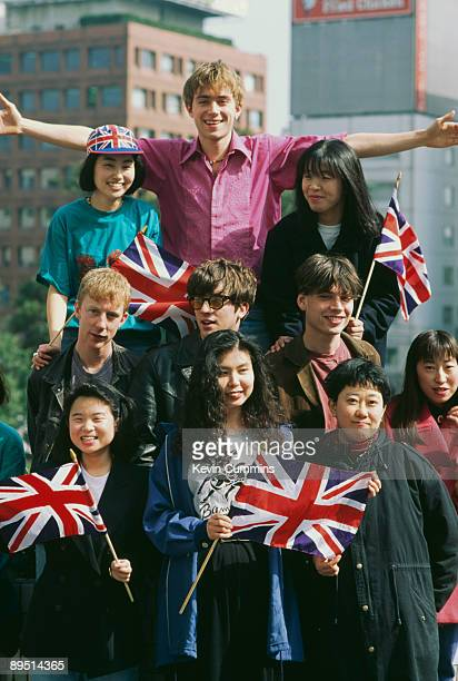 English rock band Blur in Tokyo with some female fans March 1992 Singer Damon Albarn in on top with drummer Dave Rowntree guitarist Graham Coxon and...