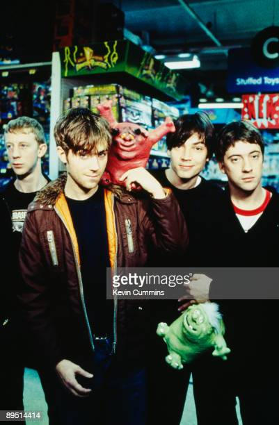 English rock band Blur pose in a toy shop 15th January 1996 From left to right drummer Dave Rowntree singer Damon Albarn bassist Alex James and...