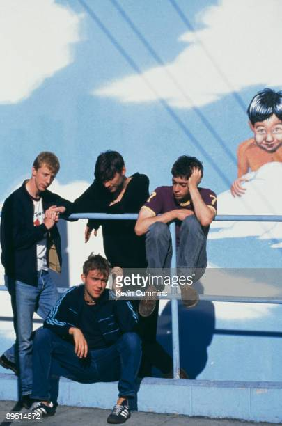 English rock band Blur pose in front of a mural 18th October 1994 From left to right drummer Dave Rowntree bassist Alex James and guitarist Graham...