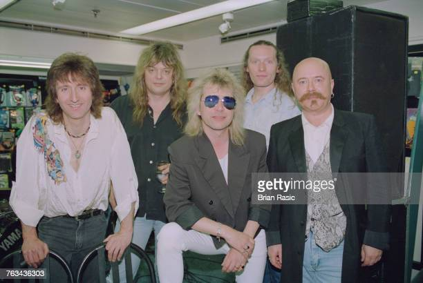 English rock band Magnum posed together at a record store concert appearance in London in June 1994 The group are from left to right bassist Colin...