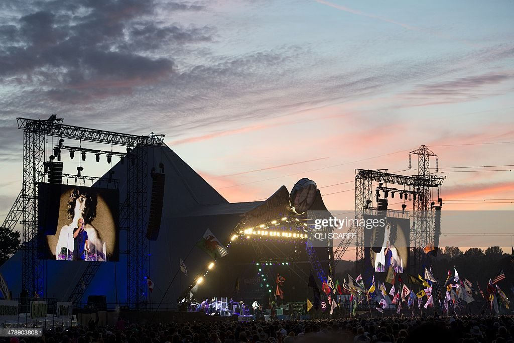 English rock band The Who perform on the Pyramid Stage at the Glastonbury Festival of Music and Performing Arts on Worthy Farm near the village of...