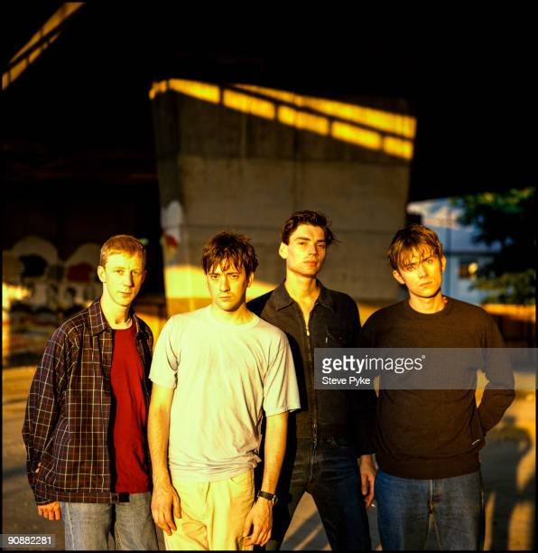 English rock group Blur pose under London's Westway circa 1995 From left to right drummer Dave Rowntree guitarist Graham Coxon bassist Alex James and...