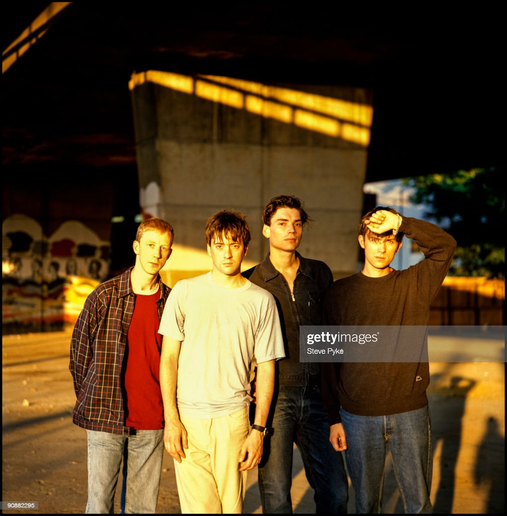 English rock group Blur pose under London's Westway, circa 1995. From left to right, drummer Dave Rowntree, guitarist Graham Coxon, bassist Alex James and singer Damon Albarn.