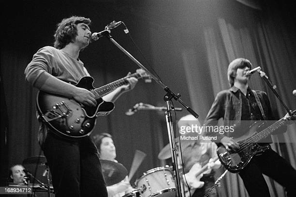 English rock group Brinsley Schwarz performing on stage 4th May 1973 Left to right Brinsley Schwarz Billy Rankin Ian Gomm and Nick Lowe