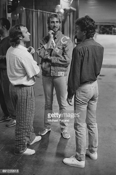 English rock group Genesis backstage at the Rosemont Horizon Rosemont Illinois during the band's Invisible Touch Tour October 1986 Left to right...