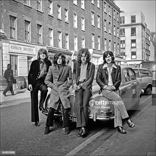 Photo of LED ZEPPELIN posed on a Jaguar car in London in December 1968 Left to right John Paul Jones Jimmy Page Robert Plant and John Bonham