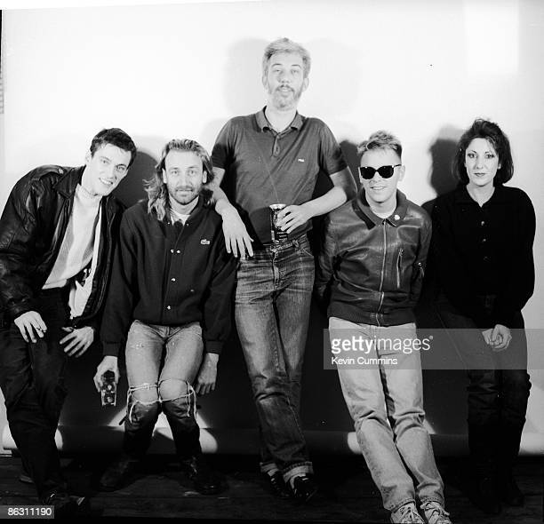 English rock group New Order with their manager Rob Gretton 1st November 1985 Left to right drummer Stephen Morris bassist Peter Hook singer Bernard...