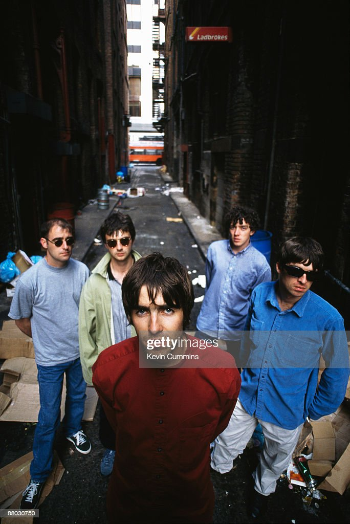 English rock group Oasis, 2nd August 1994. From left to right, rhythm guitarist Paul 'Bonehead' Arthurs, bassist <a gi-track='captionPersonalityLinkClicked' href=/galleries/search?phrase=Paul+McGuigan&family=editorial&specificpeople=226955 ng-click='$event.stopPropagation()'>Paul McGuigan</a>, singer <a gi-track='captionPersonalityLinkClicked' href=/galleries/search?phrase=Liam+Gallagher&family=editorial&specificpeople=202958 ng-click='$event.stopPropagation()'>Liam Gallagher</a>, drummer Tony McCarroll and guitarist <a gi-track='captionPersonalityLinkClicked' href=/galleries/search?phrase=Noel+Gallagher&family=editorial&specificpeople=209146 ng-click='$event.stopPropagation()'>Noel Gallagher</a>.
