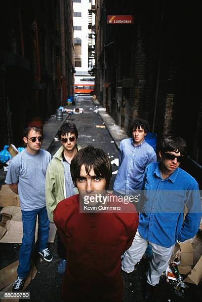 English rock group Oasis 2nd August 1994 From left to right rhythm guitarist Paul 'Bonehead' Arthurs bassist Paul McGuigan singer Liam Gallagher...