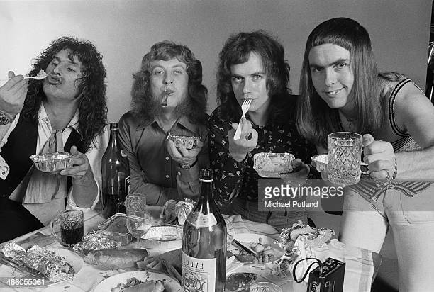 English rock group Slade posing with a takeaway meal London 1974 Left to right drummer Don Powell singer Noddy Holder bassist Jim Lea and guitarist...
