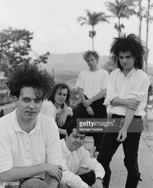 English rock group The Cure in Brazil during their 1987 tour 30th March 1987 Left to right singer Robert Smith guitarist Porl Thompson keyboard...