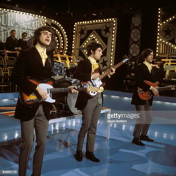 Photo of KINKS Ray Davies Pete Quaife Dave Davies performing on TV show wearing hunting jackets costume outfits