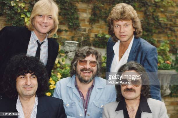 English rock group The Moody Blues posed together in 1981 Back left to right singer Justin Hayward and bassist John Lodge Front keyboard player...