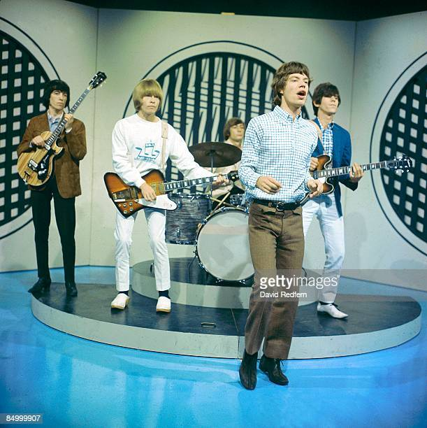 Bill Wyman Brian Jones Charlie Watts Mick Jagger Keith Richards performing on TV Show
