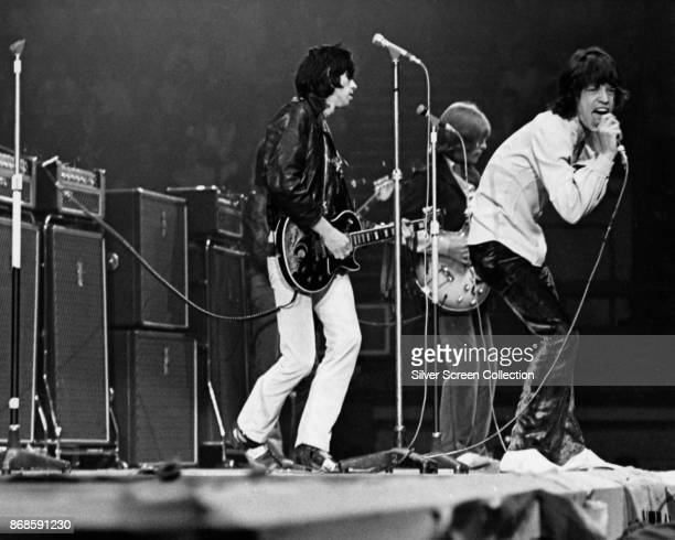 English Rock group the Rolling Stones perform onstage at an unspecified venue mid to late 1960s Pictured are from left Keith Richards and Brian Jones...