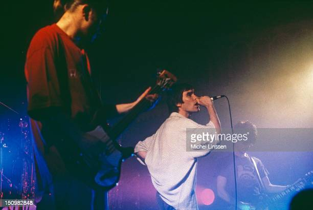 English rock group the Stone Roses performing on stage 1995 Left to right bassist Mani singer Ian Brown and guitarist John Squire