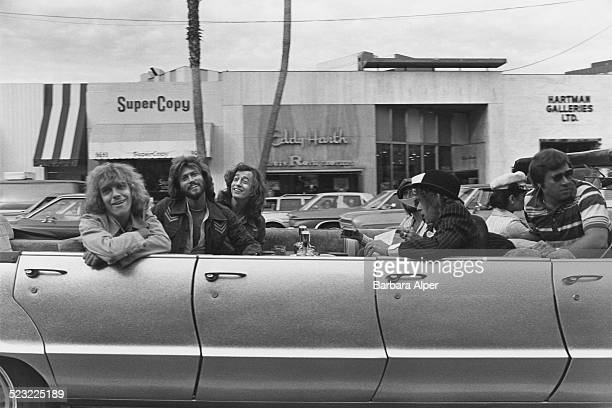 English rock musician singer and songwriter Peter Frampton with singers songwriters and record producers Barry Gibb and Robin Gibb in the back of a...