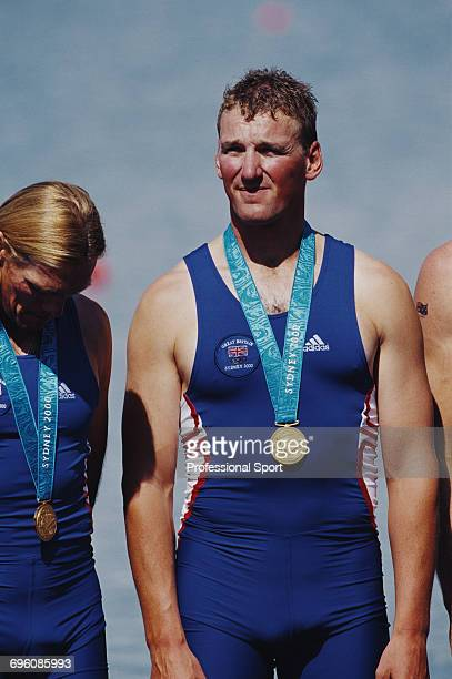 English rower Matthew Pinsent pictured wearing his gold medal on the podium after the Great Britain team finished in first place to win the gold...