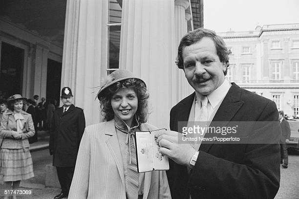 English rugby player and excaptain of the England rugby union team Bill Beaumont pictured with his OBE at an investiture ceremony at Buckingham...