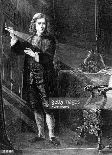 English scientist and mathematician Sir Isaac Newton creating a shaft of light circa 1665 By 1684 he demonstrated the whole gravitation theory and in...