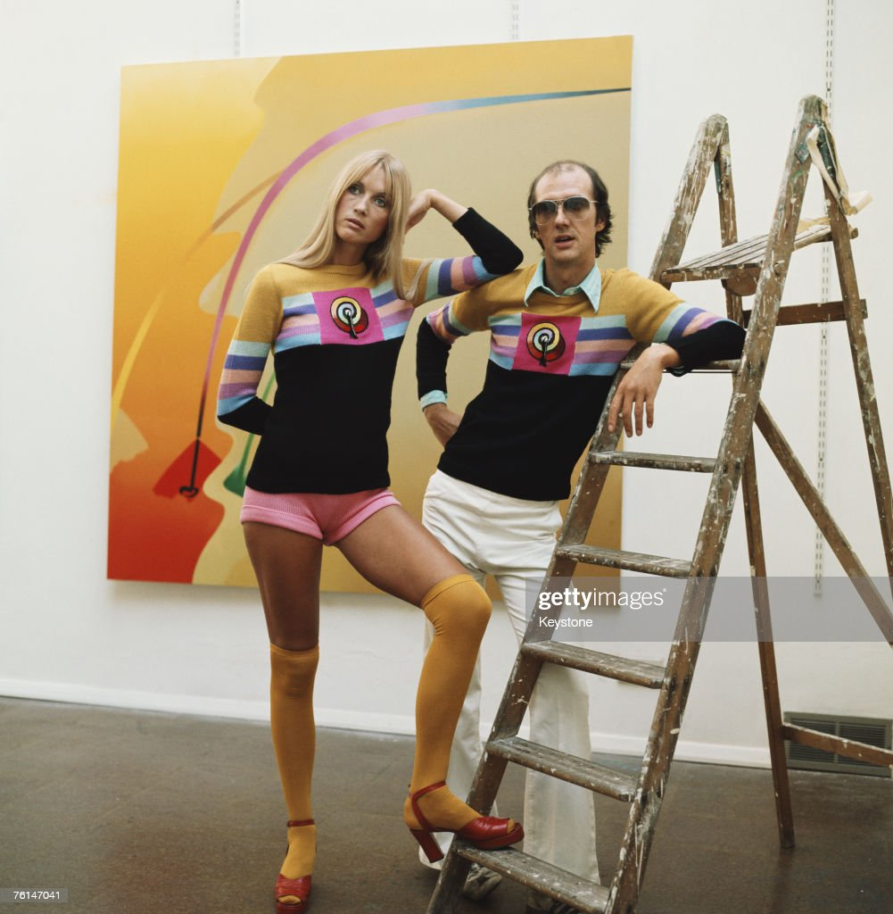 English sculptor and pop artist Allen Jones with a model in a gallery showing his work circa 1970 The couple are wearing sweaters designed by Allen...