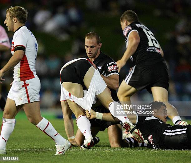 English secondrower Ben Westwood loses his shorts when he is tackled by the New Zealand defence during the Rugby League World Cup match in Newcastle...