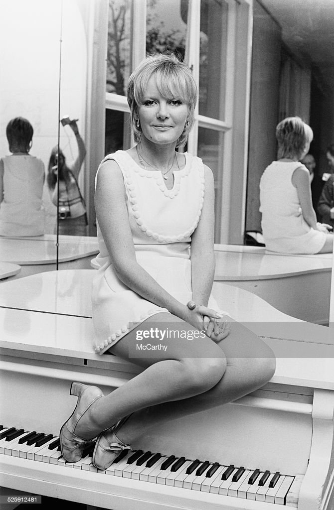 English singer, actress, and composer <a gi-track='captionPersonalityLinkClicked' href=/galleries/search?phrase=Petula+Clark&family=editorial&specificpeople=208081 ng-click='$event.stopPropagation()'>Petula Clark</a> sat atop a white piano, 1969.