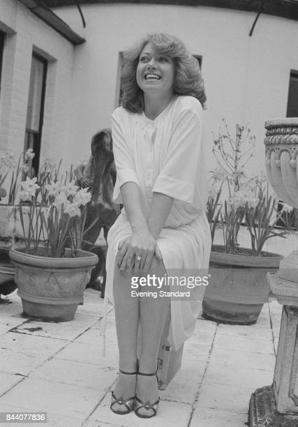 English singer and actress Elaine Paige sits on a stool in a backyard UK 6th April 1978