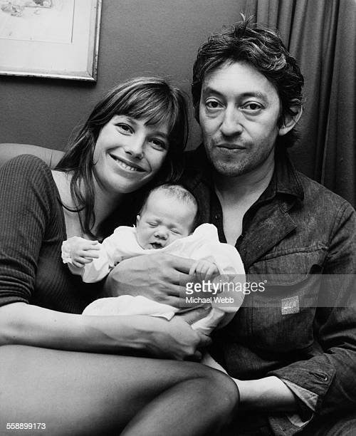 English singer and actress Jane Birkin and French singersongwriter Serge Gainsbourg with their baby daughter Charlotte at Birkin's home in Cheyne Row...