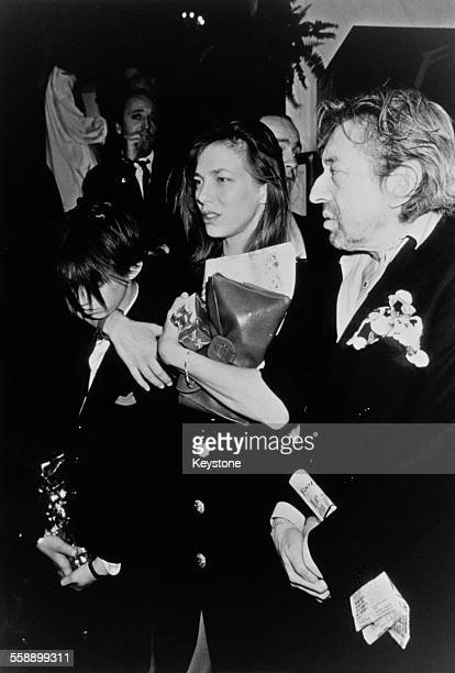 English singer and actress Jane Birkin and French singersongwriter Serge Gainsbourg with their daughter Charlotte at the César film awards Paris 22nd...